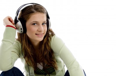 Smiling Woman Listening To Music by imagerymajestic